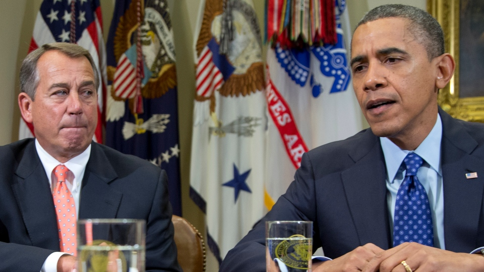 This Nov. 16, 2012 file photo shows President Barack Obama, accompanied by House Speaker John Boehner of Ohio, speaking to reporters in the Roosevelt Room of the White House in Washington. (AP Photo/Carolyn Kaster, File)
