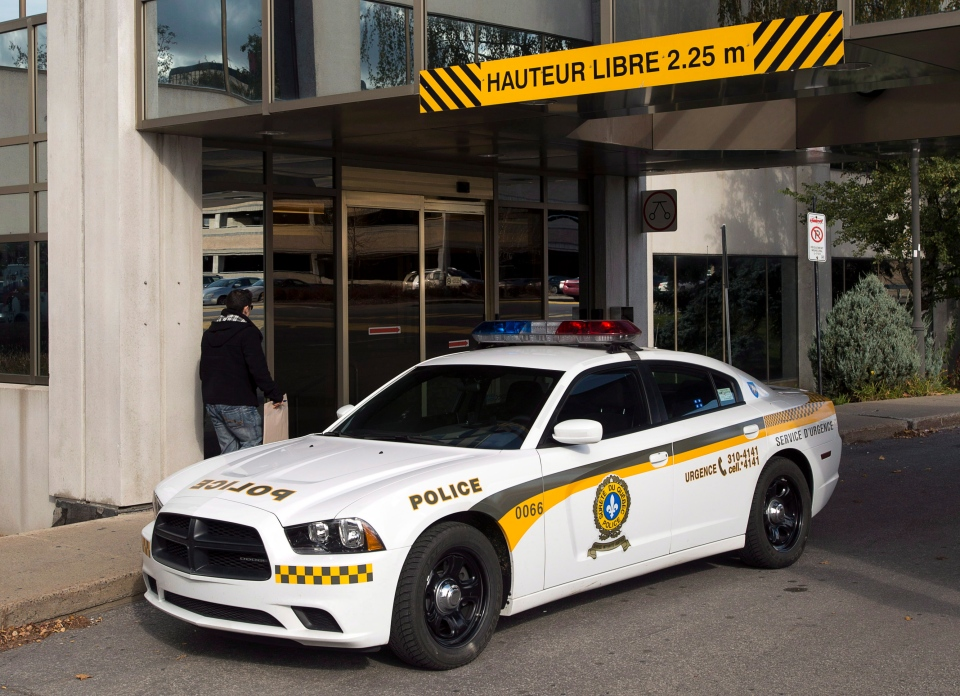 A police car sits in Laval, Quebec in this November 2012 file photo. (Ryan Remiorz/THE CANADIAN PRESS)