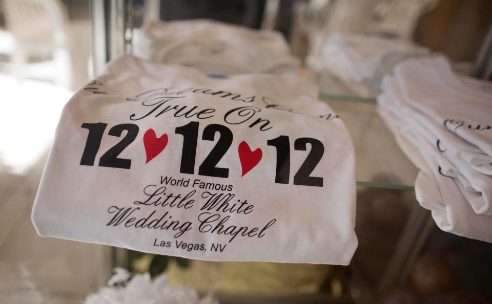 "Tee shirts advertising the 12-12-12 date sit on display at A Little White Wedding Chapel, Tuesday, Dec. 11, 2012, in Las Vegas. These ""once-in-a-century"" wedding dates have become more important each year as people increasingly look outside of Vegas for nontraditional wedding. Once known as the wedding capital of the world, Vegas' share of the U.S. wedding market has fallen by a third since 2004. Tuesday, Dec. 11, 2012, in Las Vegas. (AP Photo/Julie Jacobson)"