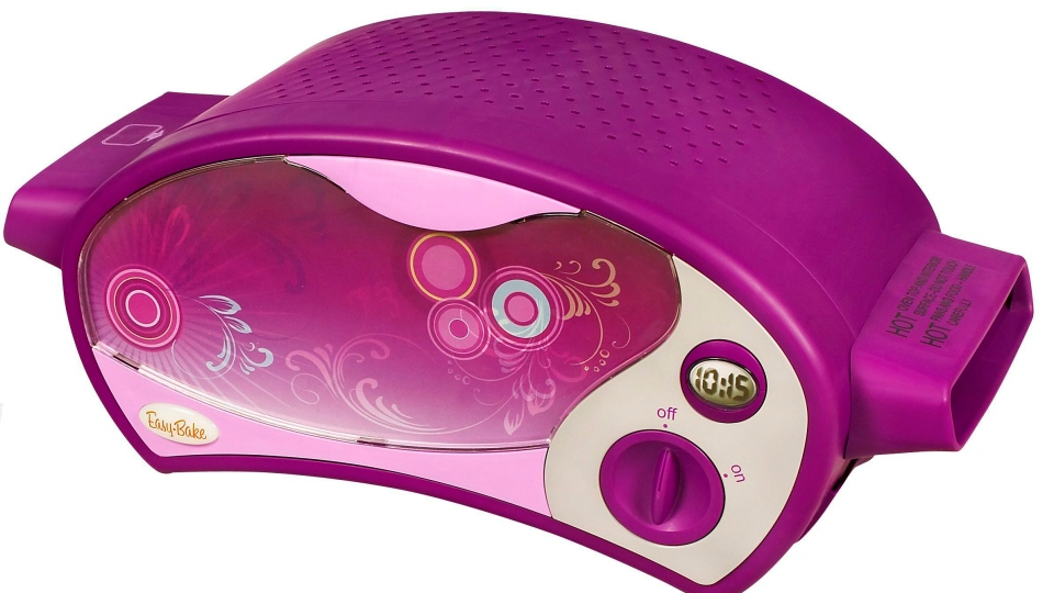 This product image courtesy of Hasbro shows the Easy-Bake Ultimate Oven. This version of the classic is space-agey in purple and doesn't require a light bulb. (AP Photo//Hasbro)