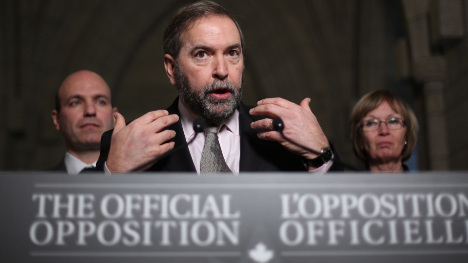 NDP Leader Thomas Mulcair holds a news conference flanked by caucus members Nathan Cullen (left) and Nycole Turmel (right) after concluding a meeting with his caucus on Parliament Hill in Ottawa, Wednesday, Dec. 12, 2012. (Fred Chartrand / THE CANADIAN PRESS)