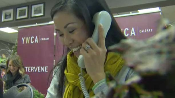 CTV Morning Live Calgary's Pearl Tsang takes donations over the phone.