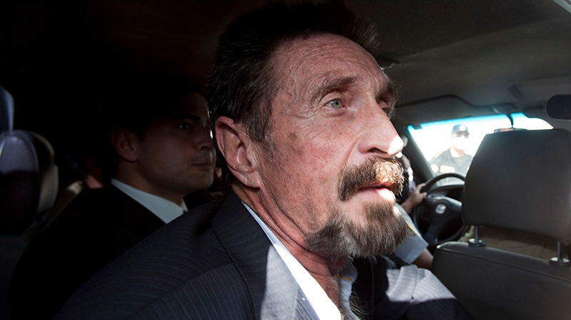 Software company founder John McAfee leaves an immigration detention center for the La Aurora international airport in Guatemala City, Wednesday Dec. 12, 2012. (AP / Moises Castillo)