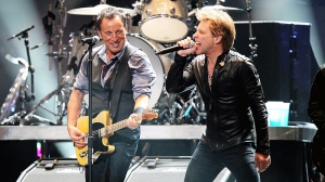 Bruce Springsteen, left, and Jon Bon Jovi perform at 12-12-12, The Concert for Sandy Relief at Madison Square Garden in New York on Wednesday, Dec. 12, 2012. (AP / Starpix, Dave Allocca)