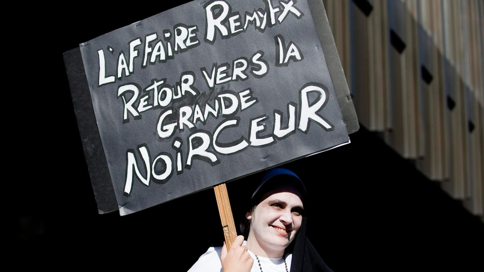 Annie-Claudene Tremblay demonstrates outside the courthouse, in Montreal, Wednesday, Oct. 13, 2010. (Graham Hughes / THE CANADIAN PRESS)