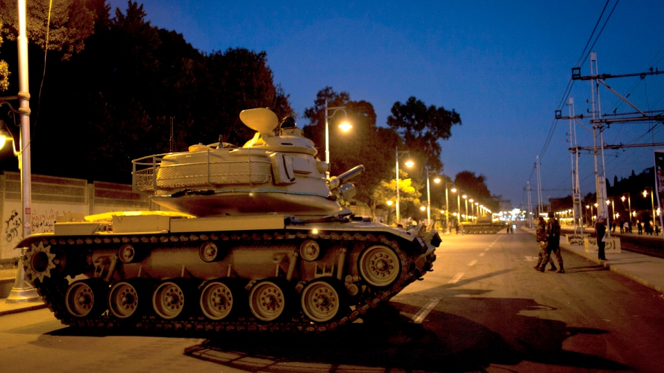 Egyptian army tanks guard in front the presidential palace in Cairo, Egypt, Wednesday, Dec. 12, 2012. (AP / Nasser Nasser)