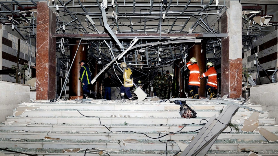 Damage after an explosion hit the main gate of the Syrian Interior Ministry in Damascus, Syria, is seen on Wednesday, Dec. 12, 2012. (SANA)