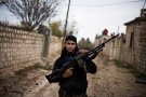 A Free Syrian Army fighter poses as he carries his weapon in the northern province of Aleppo, Syria on Dec. 12, 2012. (AP / Manu Brabo)