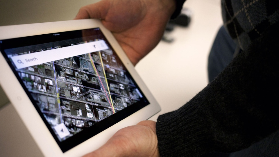 The new Google Maps application is demonstrated in New York on Thursday, Dec. 13, 2012. (AP / Karly Domb Sadof)