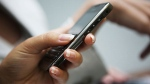 Using your cell phone number, fraudsters can take control of your online identity. (File Photo)