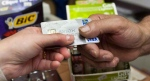 A consumer pays with a credit card for a purchase on July 6, 2010. (Ryan Remiorz / THE CANADIAN PRESS)