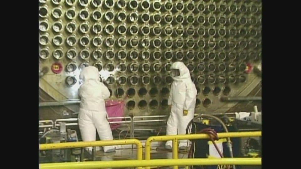 Workers in protective gear are seen at Bruce Power's nuclear site.