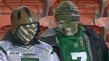 Fans of the Roughriders cast their gaze downward.