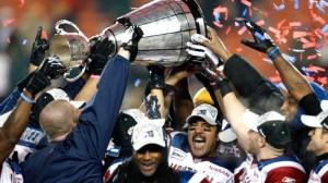 Montreal Alouettes players including quarterback Anthony Calvillo (centre) celebrate their win in the CFL Grey Cup game Sunday November 28, 2010 in Edmonton. (Adrian Wyld / THE CANADIAN PRESS)