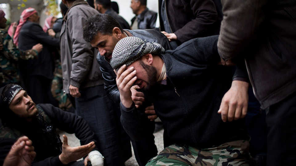 A Free Syrian Army fighter cries during the funeral of his comrade killed by the Syrian Army in Azaz, Syria, Thursday, Dec .13, 2012. (AP / Manu Brabo)