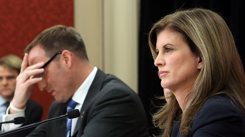Defence Minister Peter MacKay and Public Works Minister Rona Ambrose take part in a news conference on report regarding the purchase of the F-35 fighter jets on Parliament Hill in Ottawa Wednesday, Dec. 12, 2012. (Fred Chartrand / THE CANADIAN PRESS)