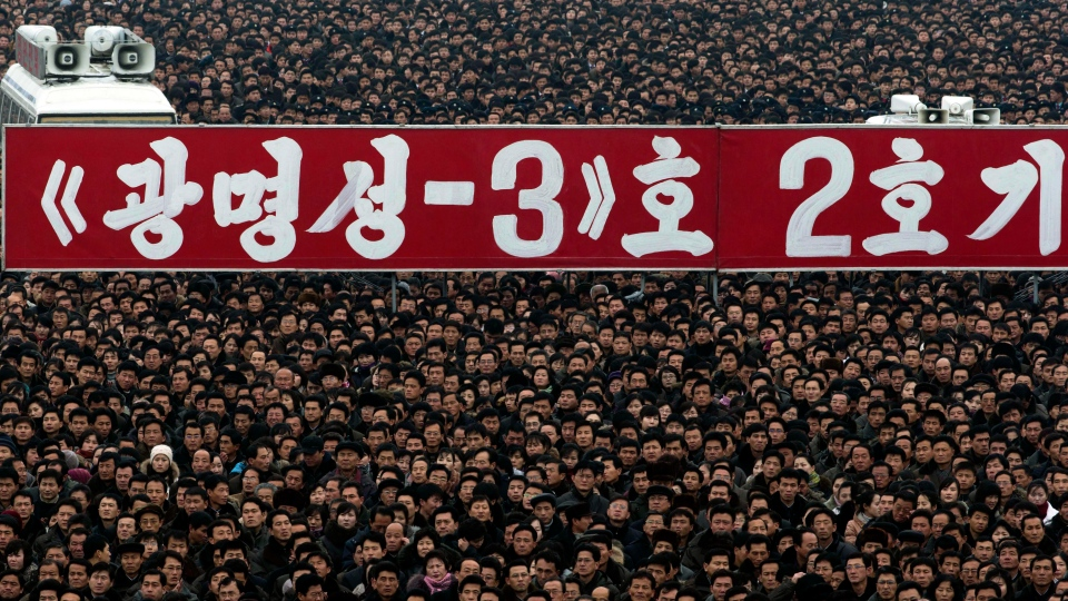 A banner that reads 'Kwangmyongsong-3 satellite 2nd version' is displayed during a mass rally organized to celebrate the success of a rocket launch that sent a satellite into space at Kim Il Sung Square in Pyongyang, North Korea, Friday, Dec. 14, 2012. (AP / Ng Han Guan)