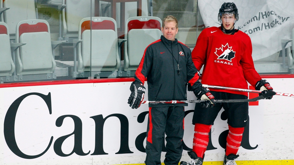Ryan Nugent-Hopkins, right, from Burnaby, B.C., stands with assistant coach Mario Duhamel during the National Junior hockey team selection camp in Calgary, Alta., on Dec. 11, 2012. (Jeff McIntosh / THE CANADIAN PRESS)