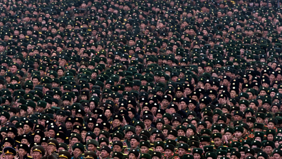 North Korean soldiers attend a mass rally organized to celebrate the success of a rocket launch that sent a satellite into space, on Kim Il Sung Square in Pyongyang, North Korea, Friday, Dec. 14, 2012. (AP / Ng Han Guan)