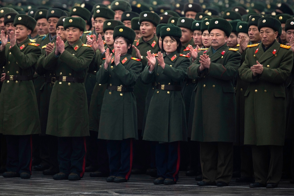 North Korean soldiers applaud during a mass rally organized to celebrate the success of a rocket launch that sent a satellite into space on Kim Il Sung Square in Pyongyang, North Korea, Friday, Dec. 14, 2012. (AP / Ng Han Guan)