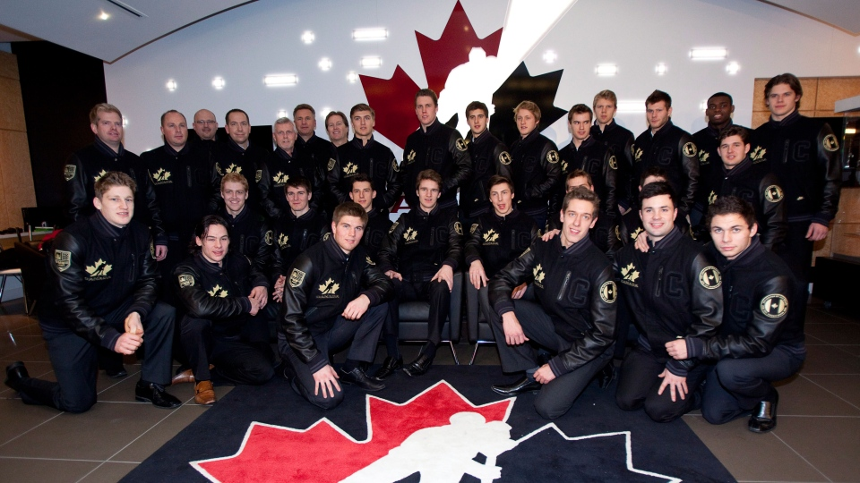Members of the Canadian National Juniors team pose during a news conference that named the team in Calgary on Thursday, Dec. 13, 2012. (Jeff McIntosh / THE CANADIAN PRESS)