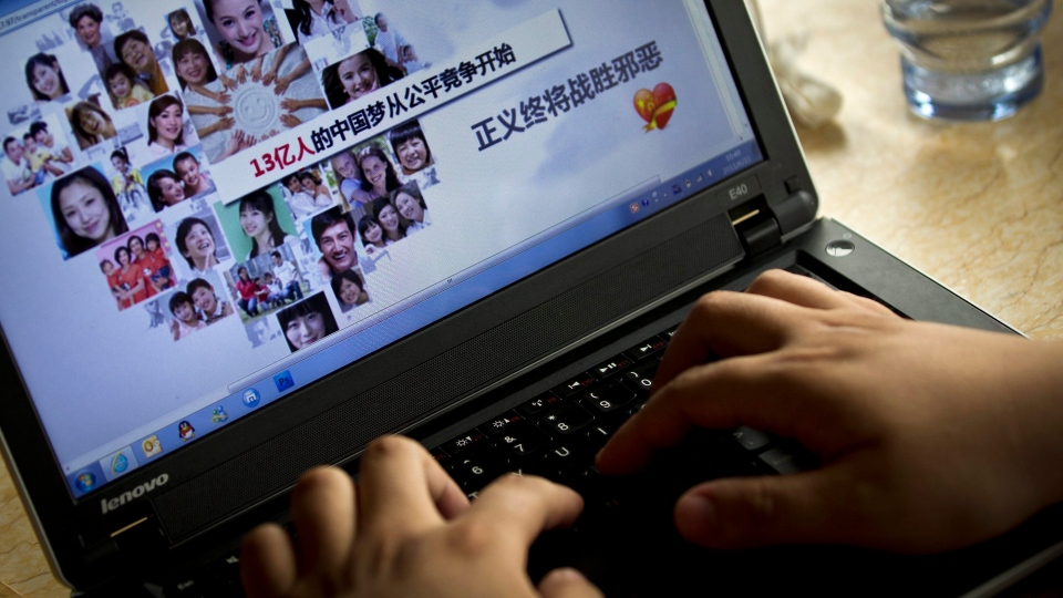 Chen Hong shows his bribery webpage on his laptop at a cafe in Beijing, China in this June 2011 file photo. (AP / Andy Wong)