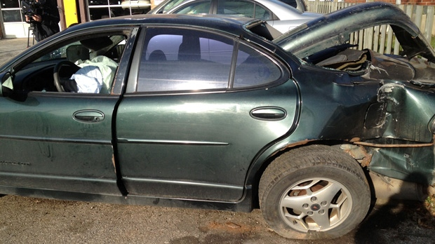 A car was destroyed after being hit by a train in Woodstock on Thursday, Dec. 13, 2012. (David Imrie / CTV Kitchener)