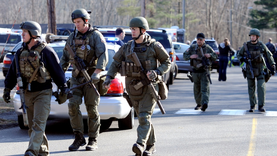 State Police are on scene following a shooting at the Sandy Hook Elementary School in Newtown, Conn., Friday, Dec. 14, 2012. (AP / Jessica Hill)