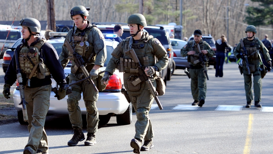 State Police are on scene following a shooting at the Sandy Hook Elementary School in Newtown, Conn. (AP / Jessica Hill)