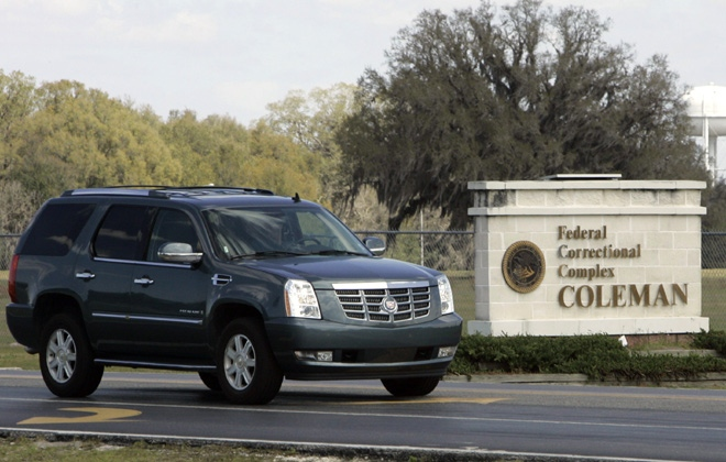 The vehicle that transported Conrad Black to the Federal Correctional Complex in Coleman, Fla., leaves the facility on Monday, March 3, 2008. (AP / John Raoux)
