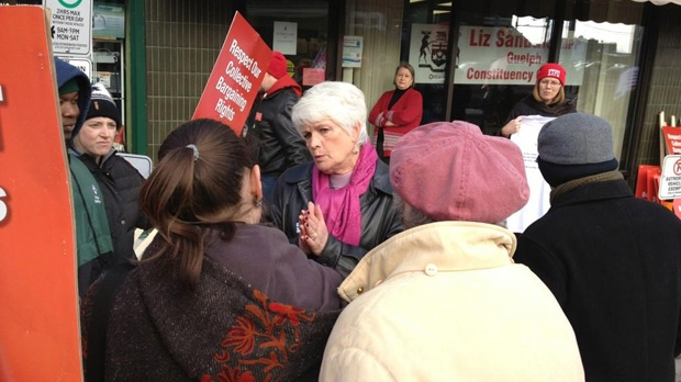 Striking teachers surround Guelph MPP Liz Sandals outside her office during a one-day strike on Friday, Dec. 14, 2012. (Abigail Bimman / CTV Kitchener)