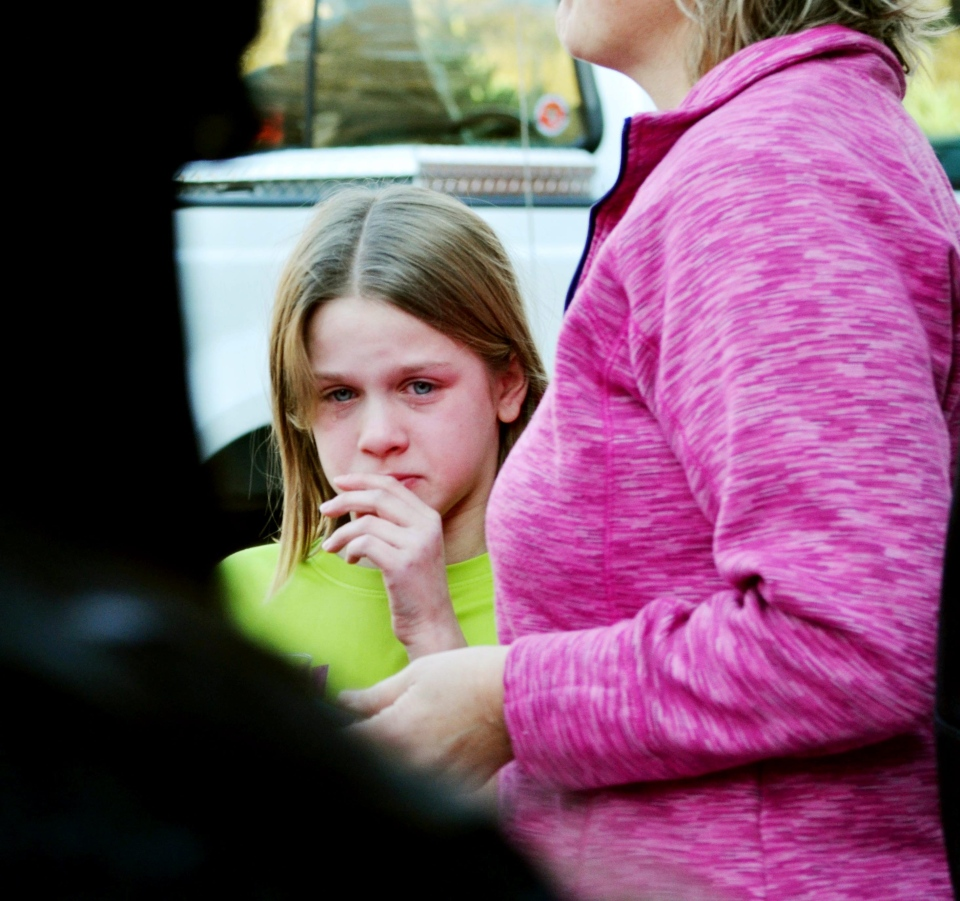 A young girl cries following a shooting at the Sandy Hook Elementary School in Newtown, Conn., about 60 miles (96 kilometers) northeast of New York City, Friday, Dec. 14, 2012.  (AP / Melanie Stengel)