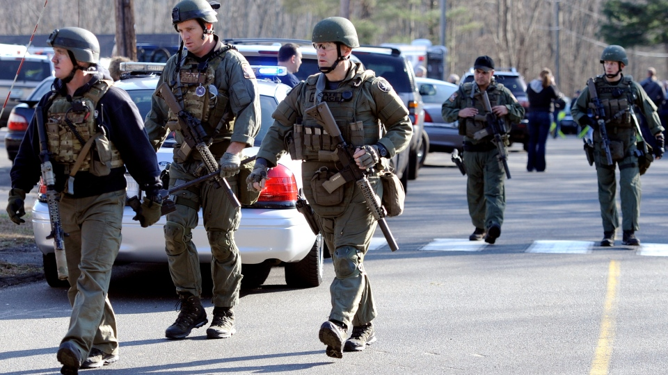 State Police are on scene following a shooting at the Sandy Hook Elementary School in Newtown, Conn., about 96 kilometres northeast of New York City, Friday, Dec. 14, 2012. (AP / Jessica Hill)