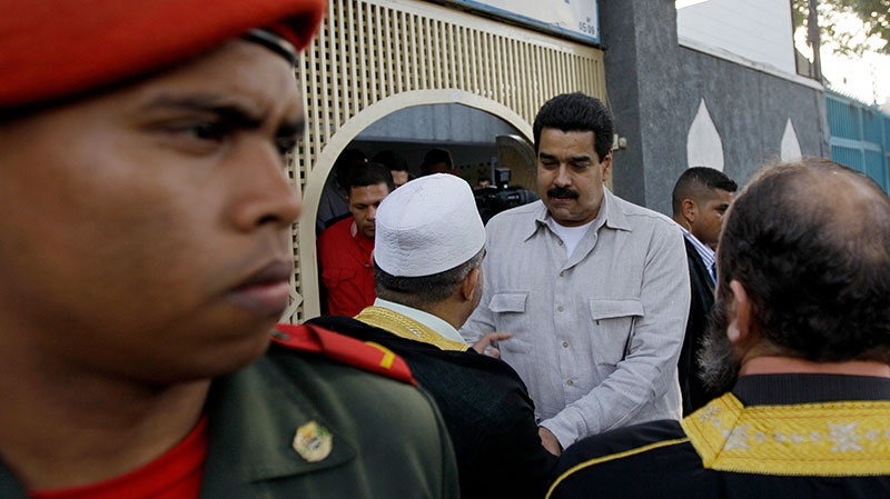 Venezuela's Vice President Nicolas Maduro, center right, talks with members of Venezuela's Islamic community after their meeting in Caracas, Venezuela, Friday, Dec. 14, 2012. (AP / Fernando Llano)