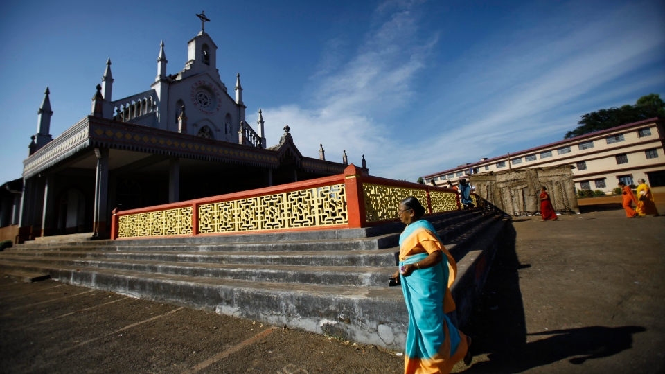 An Indian woman arrives to attend a mass prayer ceremony where Jacintha Saldanha was to be buried in Shirva, north of Mangalore, India, Saturday, Dec. 15, 2012. (AP / Rafiq Maqbool)