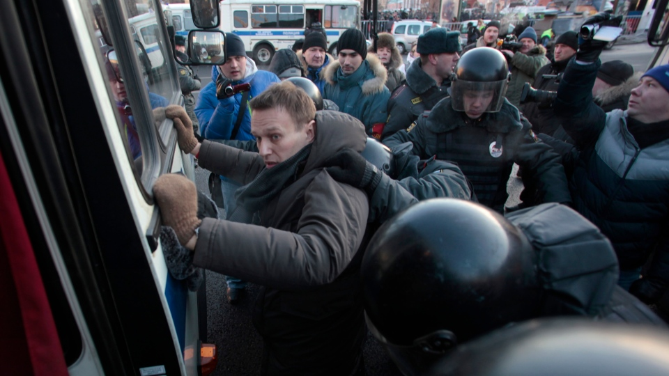 Police officers detain opposition leader Alexei Navalny during an unauthorized rally in Lubyanka Square in Moscow, Saturday, Dec. 15, 2012. (AP / Pavel Golovkin)