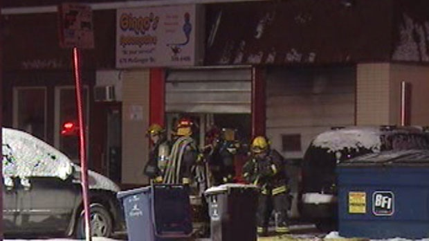 Fire crews work to battle a blaze at Gino's Automotive in the North End Friday night.