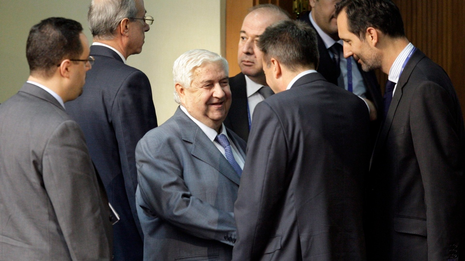 Syrian Foreign Minister, Walid al-Moallem, centre, talks with an unidentified delegate during the afternoon session of the Nonaligned Movement summit, in Tehran, Iran on Thursday, Aug. 30, 2012. (AP / Vahid Salemi)