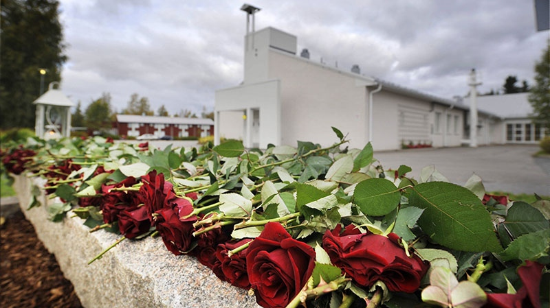 Roses are laid out on the memorial next to the Kauhajoki vocational school for those killed in the school shooting in Kauhajoki, Finland, Wednesday, Sept. 23, 2009. (Lehtikuva, Vesa Moilanen)