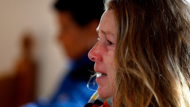 Mary Fellows reacts during a service in honor of the victims who died a day earlier when a gunman opened fire at Sandy Hook Elementary School in Newtown, Conn., as people gathered at St. John's Episcopal Church in the Sandy Hook village of Newtown, Conn., Saturday, Dec. 15, 2012. (AP / Julio Cortez)