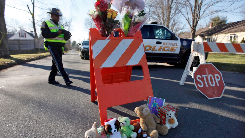 A police roadblock serves as a makeshift memorial at the corner of Riverside and Cherry Streets in Newtown, Conn., Saturday, Dec. 15, 2012. (AP / Jason DeCrow)