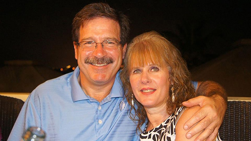 In this undated photo provided by Mark Sherlach, Mark Sherlach and his wife, school psychologist Mary Sherlach, pose for a photo. Mary Sherlach was killed Friday, Dec. 14, 2012, when a gunman opened fire at Sandy Hook Elementary School, in Newtown, Conn., killing 26 children and adults at the school. (AP / Courtesy of Mark Sherlach)