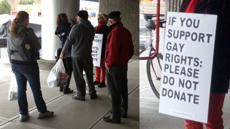An message urging supporters of gay rights not to donate is carried by a Salvation Army bell ringer outside the Tillicum Centre mall in Victoria. Dec. 15, 2012. (CTV)