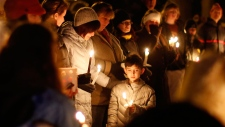 Mourners gather for a candlelight vigil Conn.
