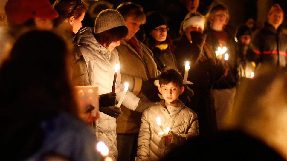 Mourners gather for a candlelight vigil at Ram's Pasture to remember shooting victims, Saturday, Dec. 15, 2012 in Newtown, Conn. (AP / Jason DeCrow)