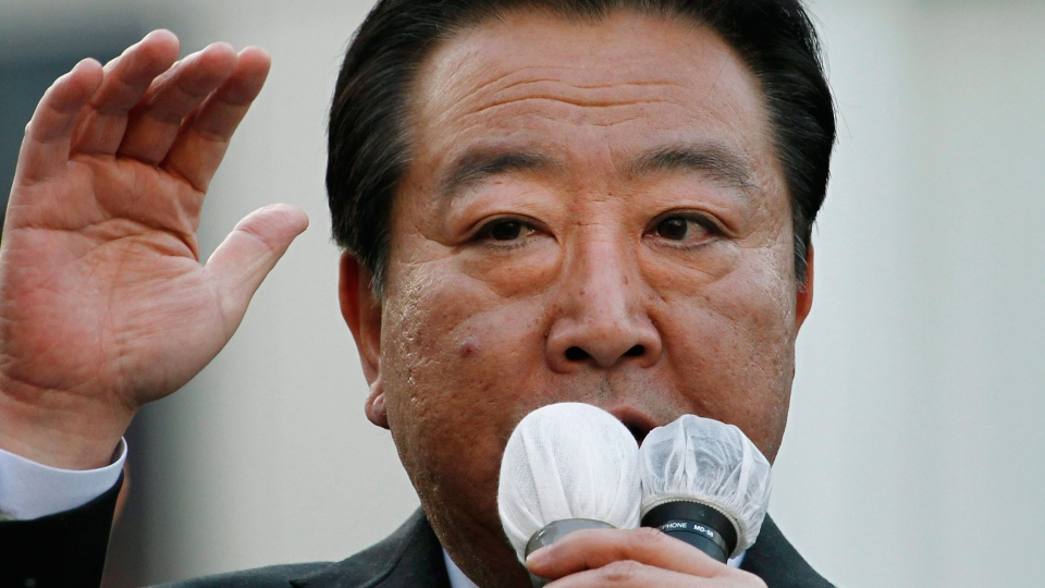 Japan's Prime Minister Yoshihiko Noda of the ruling Democratic Party of Japan delivers his speech during his parliamentary elections campaign in Tokyo Friday, Dec. 7, 2012. (AP / Koji Sasahara)