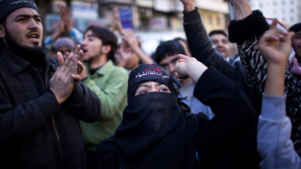 A Syrian woman chants slogans against President Bashar al-Assad during a weekly demonstration in Aleppo, Syria, Friday, Dec. 14, 2012. (AP / Manu Brabo)