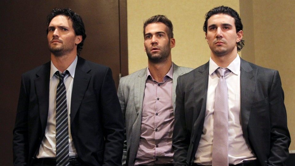 Winnipeg Jets' Ron Hainsey, left, Anaheim Ducks' Daniel Winnik, center, and Chicago Blackhawks' Chris Campoli listen as NHL Commissioner Gary Bettman and deputy commissioner Bill Daly speak to reporters in New York, Thursday, Dec. 6, 2012. (AP / Mary Altaffer)