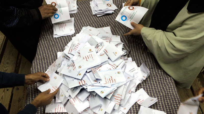 Egyptian referendum officials count votes at a polling station in Cairo, Egypt, late Saturday, Dec. 15, 2012. (AP Photo/Amr Nabil)