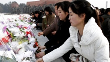 North Koreans pay respect to Kim Jong II